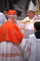 Cardinal Mario Aurelio Poli of Argentinareceives his beret as he is being appointed cardinal by Pope Francis  at the consistory in the St. Peter's Basilica at the Vatican on February 22, 2014.