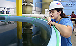 WATERBURY CT. 23 June 2017-062317SV07-Jessica McGuire, aquaculture technician, looks over fish tanks at Great American Aquaculture in Waterbury Friday. <br /> Steven Valenti Republican-American