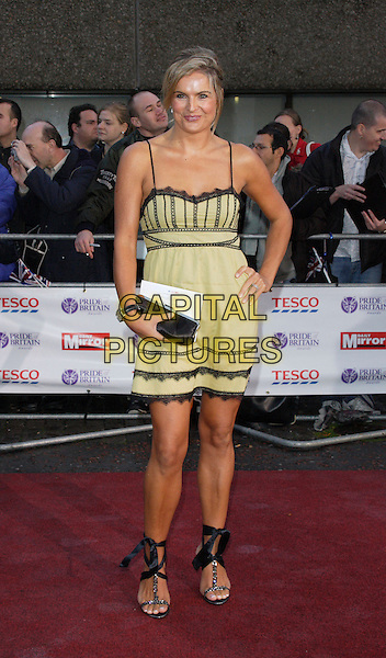 KATY HILL.The Pride of Britain Awards held at ITV Studios, South Bank, London, England..October 9th 2007.full length green and black lace dress hand on hip shoes ankle ties bows ribbons sandals tanned .CAP/ROS.©Steve Ross/Capital Pictures