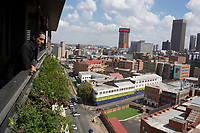 MABONENG, SOUTH AFRICA - MARCH 22: Property developer Jonathan Liebmann looks out from an apartment in one of his latest projects, Hallmark House in Maboneng district on March 22, 2016 in downtown Johannesburg, South Africa. The building is the idea of Mr. Liebmann and celebrated architect David Adjaye. Maboneng is mostly owned and controlled by Mr. Liebmann. A former derelict industrial area, and a no-go area after dark, Maboneng is now a vibrant area with artists, businesses, galleries and tourists. A racially mixed cultural hub with markets on the weekend. (Photo by Per-Anders Pettersson/Getty Images)
