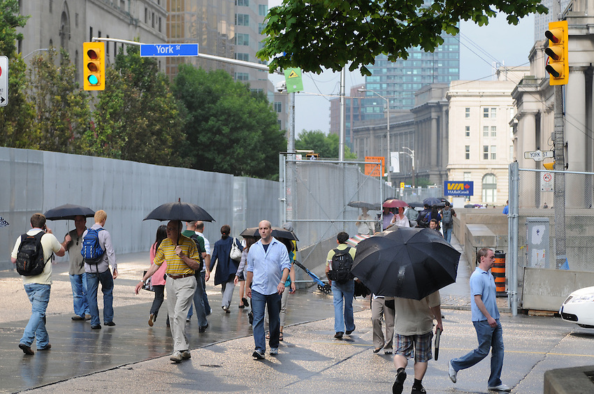 Security preparations, a chain link fence with concrete base in front of Union Station and The Royal York Hotel, in advance of the June 2010 G20 Summit meetings in Toronto, rendering Toronto with an Orwellian paint brush