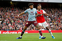 Pierre-Emerick Aubameyang of Arsenal and Tyrone Mings of Aston Villa during the Premier League match between Arsenal and Aston Villa at the Emirates Stadium, London, England on 22 September 2019. Photo by Carlton Myrie / PRiME Media Images.