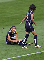 LA Sol's Han Duan lends a hand to teammate Marta. The LA Sol defeated the Washington Freedom 2-0 in the opening game of Womens Professional Soccer at Home Depot Center stadium on Sunday March 29, 2009.  .Photo by Michael Janosz