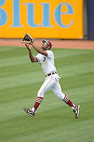 Right fielder D'Vontrey Richardson #27 of the Florida State Seminoles tracks a fly ball at Durham Bulls Athletic Park May 24, 2009 in Durham, North Carolina. The Virginia Cavaliers defeated the Florida State Seminoles 6-3 to win the 2009 ACC Baseball Championship.  (Photo by Brian Westerholt / Four Seam Images)