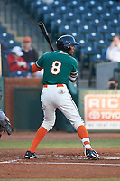 Garvis Lara (8) of the Greensboro Grasshoppers at bat against the Augusta GreenJackets at First National Bank Field on April 10, 2018 in Greensboro, North Carolina.  The GreenJackets defeated the Grasshoppers 5-0.  (Brian Westerholt/Four Seam Images)