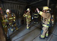NWA Democrat-Gazette/ANDY SHUPE<br /> Mauro Campos (right), battalion chief for the Fayetteville Fire Department, leads a tour Wednesday, March 7, 2018, of the training facility during a training workshop for fire department leadership to meet current National Fire Protection Association standards at the Fayetteville Fire Department training facility in south Fayetteville. Thirty students and instructors from agencies in seven states attended the training meant to train department training officers at current standards.