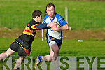 Tralee's Jamie Byrne pushes passed the Old Christians defence at O'Dowd park, Tralee on Saturday.