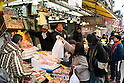 People shop in Ameyoko for the New Year holidays