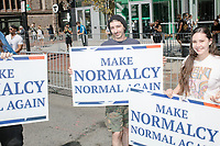 "People hold signs reading ""Make Normalcy Normal Again"" before marching in the Straight Pride Parade in Boston, Massachusetts, on Sat., August 31, 2019."
