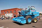 Kids and combine parade at the start of the 24th Lind Combine Destruction Derby, in Adams County, Washington. Sponsored by the Lind, Wash., Lions Club.