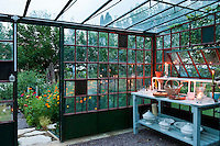 This glasshouse has been prepared to house a buffet meal in the middle of a herb garden