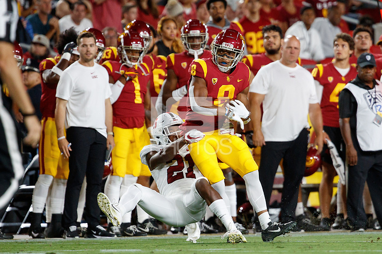 LOS ANGELES, CA - SEPTEMBER 7: Kendall Williamson #21 of the Stanford Cardinal tackles USC Trojans Amon-Ra St. Brown #8 during a game between USC and Stanford Football at Los Angeles Memorial Coliseum on September 7, 2019 in Los Angeles, California.