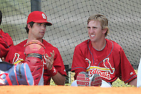 St. Louis Cardinals minor league player catcher Robert Stock talks with pitcher Jordan Swagerty #15 in the bullpen during a spring training game vs the New York Mets at the Roger Dean Sports Complex in Jupiter, Florida;  March 24, 2011.  Photo By Mike Janes/Four Seam Images