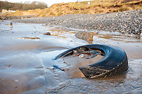 Tuesday  09 February 2016<br /> Pictured: A lorry tyre with other rubbish washed up on Pendine Beach, Carmarthenshire<br /> Re:  Debris left on the beach in the aftermath of Storm Imogen