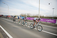 peloton tries to catch Niki Terpstra (NLD), but he's almost out of sight at this point<br /> <br /> Dwars Door Vlaanderen 2014