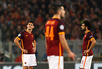 Calcio, andata degli ottavi di finale di Champions League: Roma vs Real Madrid. Roma, stadio Olimpico, 17 febbraio 2016.<br /> From left, Roma's Diego Perotti, Kostas Manolas and Mohamed Salah react after Real Madrid scored during the first leg round of 16 Champions League football match between Roma and Real Madrid, at Rome's Olympic stadium, 17 February 2016.<br /> UPDATE IMAGES PRESS/Riccardo De Luca