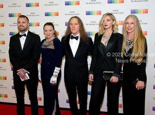 Timothy B. Schmidt, center, and his wife, Jean, right, arrive with their children for the formal Artist's Dinner honoring the recipients of the 39th Annual Kennedy Center Honors hosted by United States Secretary of State John F. Kerry at the U.S. Department of State in Washington, D.C. on Saturday, December 3, 2016. The 2016 honorees are: Argentine pianist Martha Argerich; rock band the Eagles; screen and stage actor Al Pacino; gospel and blues singer Mavis Staples; and musician James Taylor.  From left to right: Son Ben Schmidt; Jeddrah Leiterding; Timothy B. Schmidt; Owen Schmidt; daughter; and wife Jean.<br /> Credit: Ron Sachs / Pool via CNP