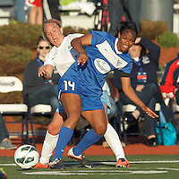 Boston Breakers defender Kia McNeill (14) attempts to control the ball as Chicago Red Stars forward/midfielder Alyssa Mautz (4) pressures. In a National Women's Soccer League Elite (NWSL) match, the Boston Breakers (blue) defeated Chicago Red Stars (white), 4-1, at Dilboy Stadium on May 4, 2013.
