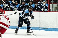 BOSTON, MA - JANUARY 04: Morgan Trimper #3 of University of Maine brings the puck forward during a game between University of Maine and Boston University at Walter Brown Arena on January 04, 2020 in Boston, Massachusetts.
