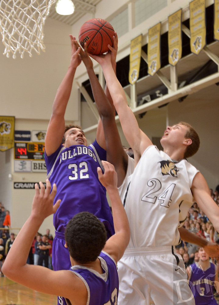 NWA Democrat-Gazette/BEN GOFF -- 01/30/15 CJ O'Grady (left) of Fayetteville and Ben Smith of Bentonville jump for a rebound during the game in Bentonville's Tiger Arena on Friday, Jan. 30, 2015.