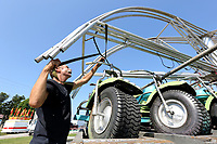 NWA Democrat-Gazette/DAVID GOTTSCHALK Tim Allen, with Mitchell Brothers Amusements, begins to assemble Monday, August 5, 2019, a Hampton combination motorcycle and automobile children's ride at St. Joseph's Catholic Church in Tontitown for the 121th Tontitown Grape Festival. The festival begins today and runs thru Saturday August 10. Homemade spaghetti will be served August 8 thru Aug. 10. For more information see tontitowngrapefestival.com.