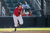 John Ziznewski (5) of the Kannapolis Intimidators follows through on his swing against the Asheville Tourists at Intimidators Stadium on June 28, 2015 in Kannapolis, North Carolina.  The Tourists defeated the Intimidators 6-4.  (Brian Westerholt/Four Seam Images)