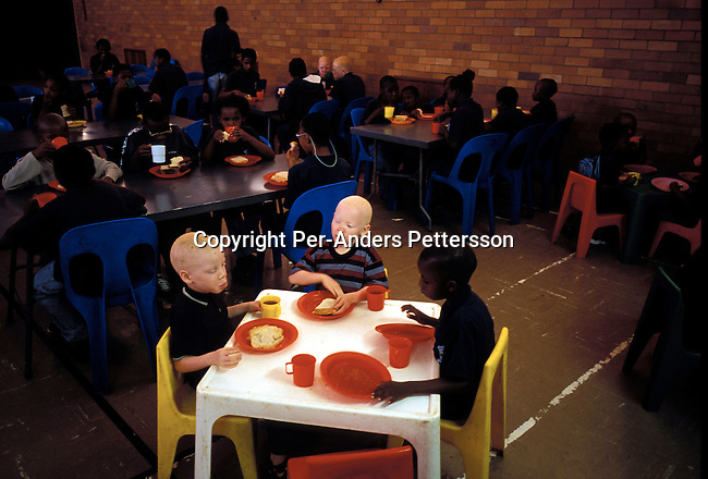 dieduca00264 Education/ Disable/ Blind KLIPRIVER, SOUTH AFRICA APRIL 16: (GERMANY OUT) Children eats breakfast in the dining room on April 16, 2003 at Sibonile (means: we have seen) School for the Blind in Klipriver, south of Johannesburg, South Africa. A blind woman founded the school in 1994. The school has about 125 students from disadvantaged communities around South Africa. Many of the children have faced rejection from their families and communities, and at Sibonile they have a chance for a good education. Hostel.(Photo: Per-Anders Pettersson/iAfrika Photos)..