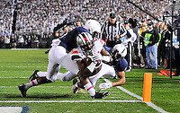 25 October 2014:  Ohio State RB Ezekiel Elliott (15) dives across the goal line for a 10 yard  touchdown, while Penn State S Adrian Amos (4) and S Marcus Allen (2) hit him. The Ohio State Buckeyes defeated the Penn State Nittany Lions 31-24 in 2 OTs at Beaver Stadium in State College, PA.