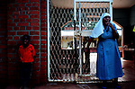 A Catholic nun stands with one of her charges on the edge of a playground at an orphanage in Morogoro, Tanzania on October 6, 2008.