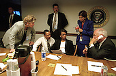 United States Vice President Dick Cheney, right, speaks to U.S. President George W. Bush by phone inside the operations center at the White House with staff, Tuesday afternoon, September 11, 2001.   Visible in the photo are advisors Karen Hughes, left, and National Security Advisor Condoleezza Rice, center..Credit: David Bohrer - White House via CNP