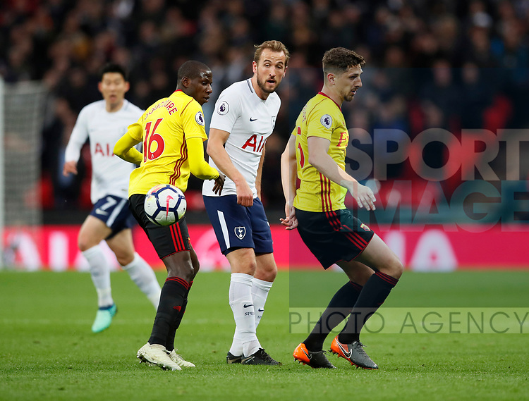 Harry Kane of Tottenham between Abdoulaye Doucoure and Craig Cathcart of Watford during the premier league match at Wembley Stadium, London. Picture date 30th April 2018. Picture credit should read: David Klein/Sportimage