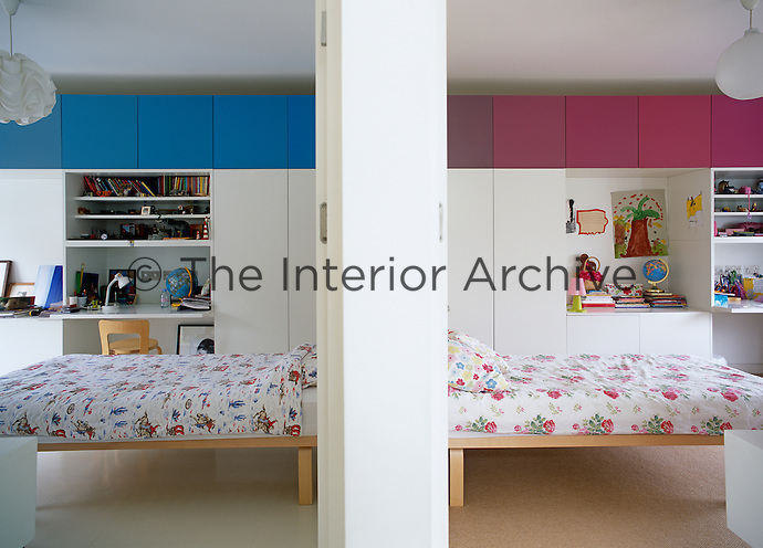 Looking through open doorways to symmetrically set out childrens bedrooms.