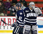 Kevin Goumas (UNH - 27), Matt Di Girolamo (UNH - 30) - The Harvard University Crimson defeated the University of New Hampshire Wildcats 7-6 on Tuesday, November 22, 2011, at Bright Hockey Center in Cambridge, Massachusetts.