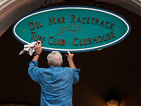 DEL MAR, CA - NOVEMBER 04: A worker cleans a sign on Day 1 of the 2017 Breeders' Cup World Championships at Del Mar Thoroughbred Club on November 4, 2017 in Del Mar, California. (Photo by Carson Dennis/Eclipse Sportswire/Breeders Cup)