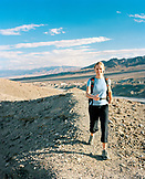 USA, California, Death Valley National Park, young woman hiking at Zabriske Point