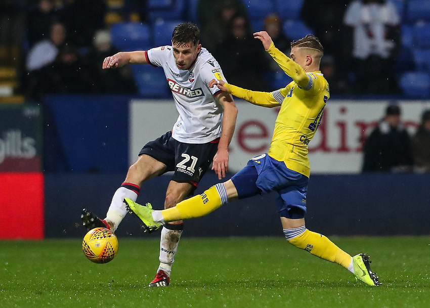 Bolton Wanderers' Joe Williams competing with Leeds United's Ezgjan Alioski<br /> <br /> Photographer Andrew Kearns/CameraSport<br /> <br /> The EFL Sky Bet Championship - Bolton Wanderers v Leeds United - Saturday 15th December 2018 - University of Bolton Stadium - Bolton<br /> <br /> World Copyright © 2018 CameraSport. All rights reserved. 43 Linden Ave. Countesthorpe. Leicester. England. LE8 5PG - Tel: +44 (0) 116 277 4147 - admin@camerasport.com - www.camerasport.com