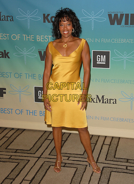 REGINA KING.The Women in Film's 2007 Crystal & Lucy Awards, The Best of The Best of 2007 held at The Beverly Hilton Hotel in Beverly Hills, California, USA..June 14th, 2007.full length yellow gold satin dress silk shoes heart necklace .CAP/DVS.©Debbie VanStory/Capital Pictures