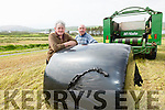 The First Cut - Michael O'Shea & Gerard Burns on the right with their first cut of silage at Liam Kelly's farm in Portmagee on Monday.