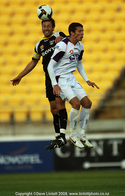 Phoenix captain Andrew Durante beats Nikita Rukavytsya to a header during the A-League football match between the Wellington Phoenix and Perth Glory at Westpac Stadium, Wellington, New Zealand on Saturday, 13 December 2008. Photo: Dave Lintott / lintottphoto.co.nz