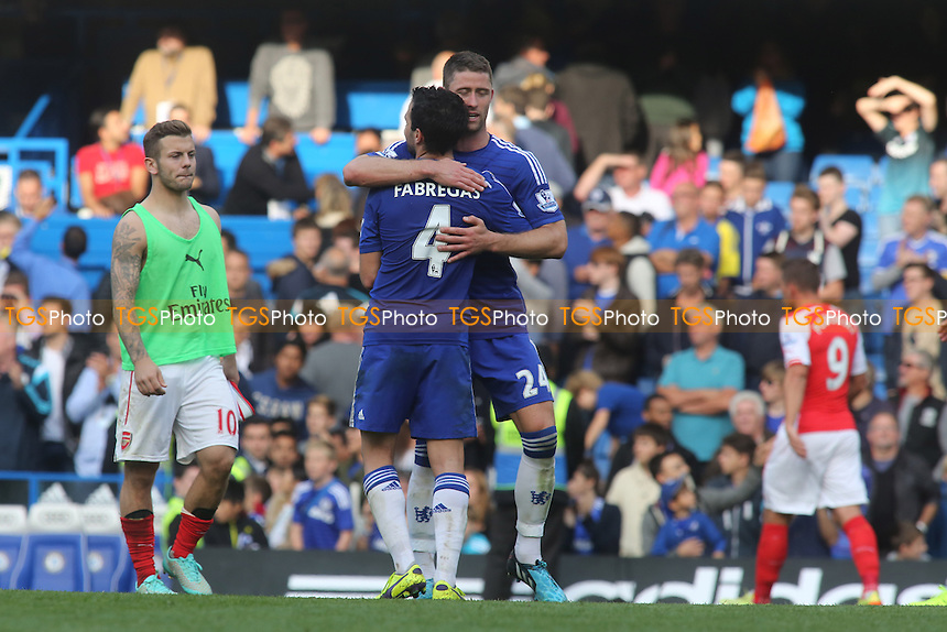 Cesc Fabregas of Chelsea celebrates at the final whistle with Gary Cahil - Chelsea vs Arsenal - Barclays Premier League Football at Stamford Bridge, London - 05/10/14 - MANDATORY CREDIT: Paul Dennis/TGSPHOTO - Self billing applies where appropriate - contact@tgsphoto.co.uk - NO UNPAID USE