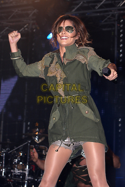 CHERYL COLE .Performs live during Radio One's Big Weekend, Bangor, North Wales, .UK, May 22nd 2010..1 1's music live on stage concert gig half length black sunglasses hand arm fist dancing microphone smiling  green khaki parka jacket coat grey gray silver shorts .CAP/MAR.© Martin Harris/Capital Pictures.