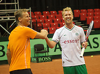 11-sept.-2013,Netherlands, Groningen,  Martini Plaza, Tennis, DavisCup Netherlands-Austria, Practice, Footbal Club FC Groningen is visiting the Dutch Daviscup team, Rasmus Lindgren (football) and Jan Siemerinkr<br /> Photo: Henk Koster