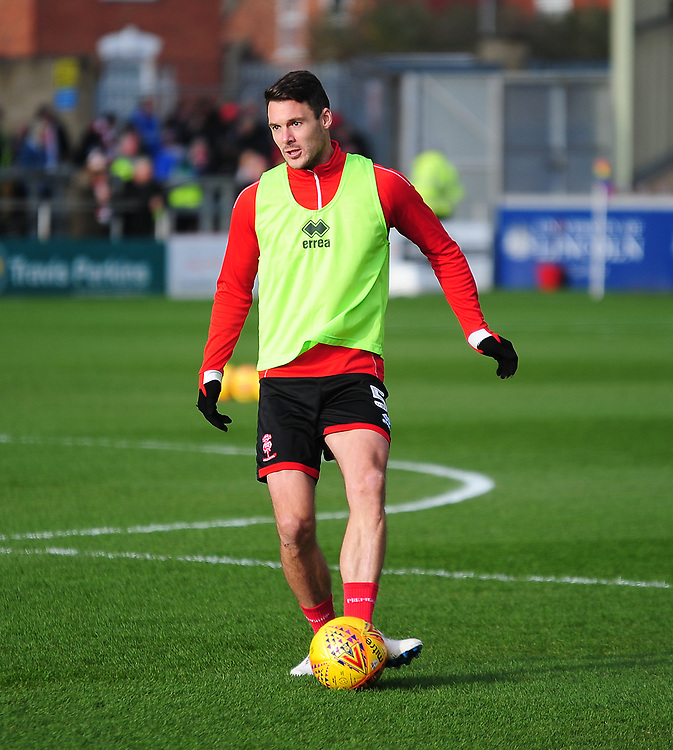 Lincoln City's Jason Shackell during the pre-match warm-up<br /> <br /> Photographer Andrew Vaughan/CameraSport<br /> <br /> The EFL Sky Bet League Two - Lincoln City v Mansfield Town - Saturday 24th November 2018 - Sincil Bank - Lincoln<br /> <br /> World Copyright © 2018 CameraSport. All rights reserved. 43 Linden Ave. Countesthorpe. Leicester. England. LE8 5PG - Tel: +44 (0) 116 277 4147 - admin@camerasport.com - www.camerasport.com