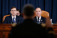 Democratic Chairman of the House Permanent Select Committee on Intelligence Adam Schiff (R) and Democratic legal counsel Daniel Goldman (L) as Director for European Affairs of the National Security Council, US Army Lieutenant Colonel Alexander Vindman is sworn in during the House Permanent Select Committee on Intelligence public hearing on the impeachment inquiry into US President Donald J. Trump, on Capitol Hill in Washington, DC, USA, 19 November 2019. The impeachment inquiry is being led by three congressional committees and was launched following a whistleblower's complaint that alleges US President Donald J. Trump requested help from the President of Ukraine to investigate a political rival, Joe Biden and his son Hunter Biden.<br /> Credit: Shawn Thew / Pool via CNP/AdMedia