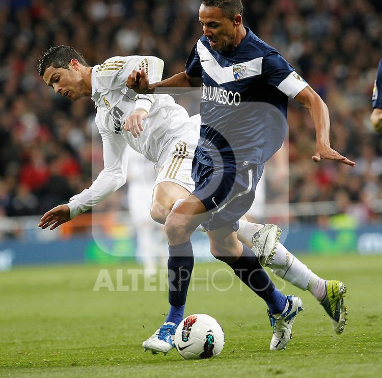 Real Madrid's Cristiano Ronaldo and Malaga's during la Liga match on march 18th 2012...Photo: Alex Cid-Fuentes / ALFAQUI