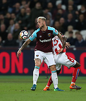 West Ham United's Marko Arnautovic and Stoke City's Bruno Martins Indi<br /> <br /> Photographer Rob Newell/CameraSport<br /> <br /> The Premier League - West Ham United v Stoke City - Monday 16th April 2018 - London Stadium - London<br /> <br /> World Copyright &copy; 2018 CameraSport. All rights reserved. 43 Linden Ave. Countesthorpe. Leicester. England. LE8 5PG - Tel: +44 (0) 116 277 4147 - admin@camerasport.com - www.camerasport.com