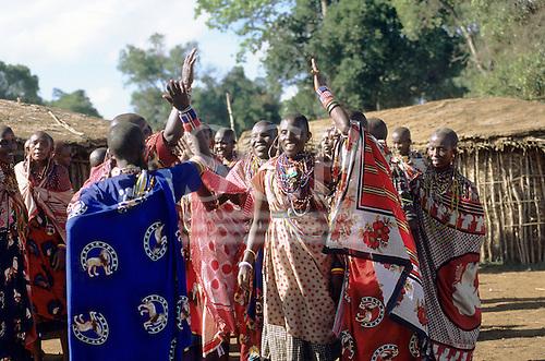 Lolgorian, Kenya. Siria Maasai Manyatta; group of women with typical beadwork adornments, earrings and bracelets.