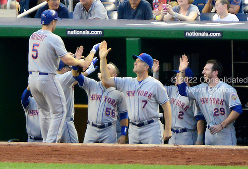 New York Mets third baseman David Wright (5) celebrates with his teammates after scoring in the first inning against the Washington Nationals at Nationals Park in Washington, D.C. on Friday, August 17, 2012..Credit: Ron Sachs / CNP.(RESTRICTION: NO New York or New Jersey Newspapers or newspapers within a 75 mile radius of New York City)
