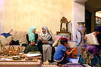 Muslim Sisters of the Nasr City's group talk in a weekly meeting where young women meet an older Sister to discuss about the role of religion. Here, in Rhada's apartment in Nasr City. Cairo, July 9th 2012. Egypt.