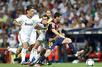MADRID, ESPANHA, 29 AGOSTO 2012 - SUPERCUP DA ESPANHA -  REAL MADRID X BARCELONA - Lionel Messi (D) jogador do Barcelona  durante partida contra o Real Madrid na final da da Supercup da Espanha contra o Barcelona em , no estadio Santiago Bernabeu, em Madri na Espanha, nesta quarta-fera, 29. (FOTO: ALFAQUI / BRAZIL PHOTO PRESS).